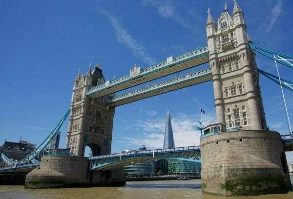 London Tower Bridge view fron river under blue sky