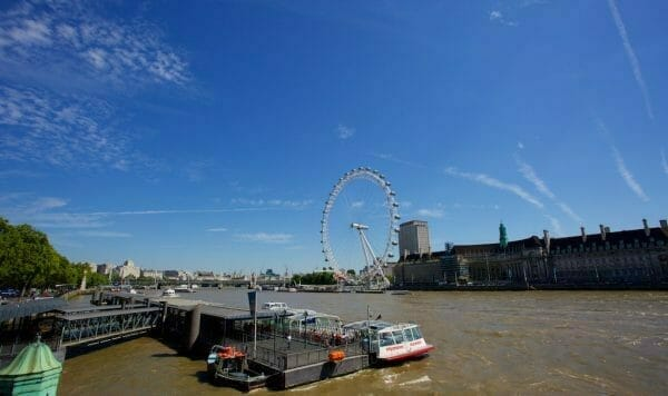 London eye under blue skies
